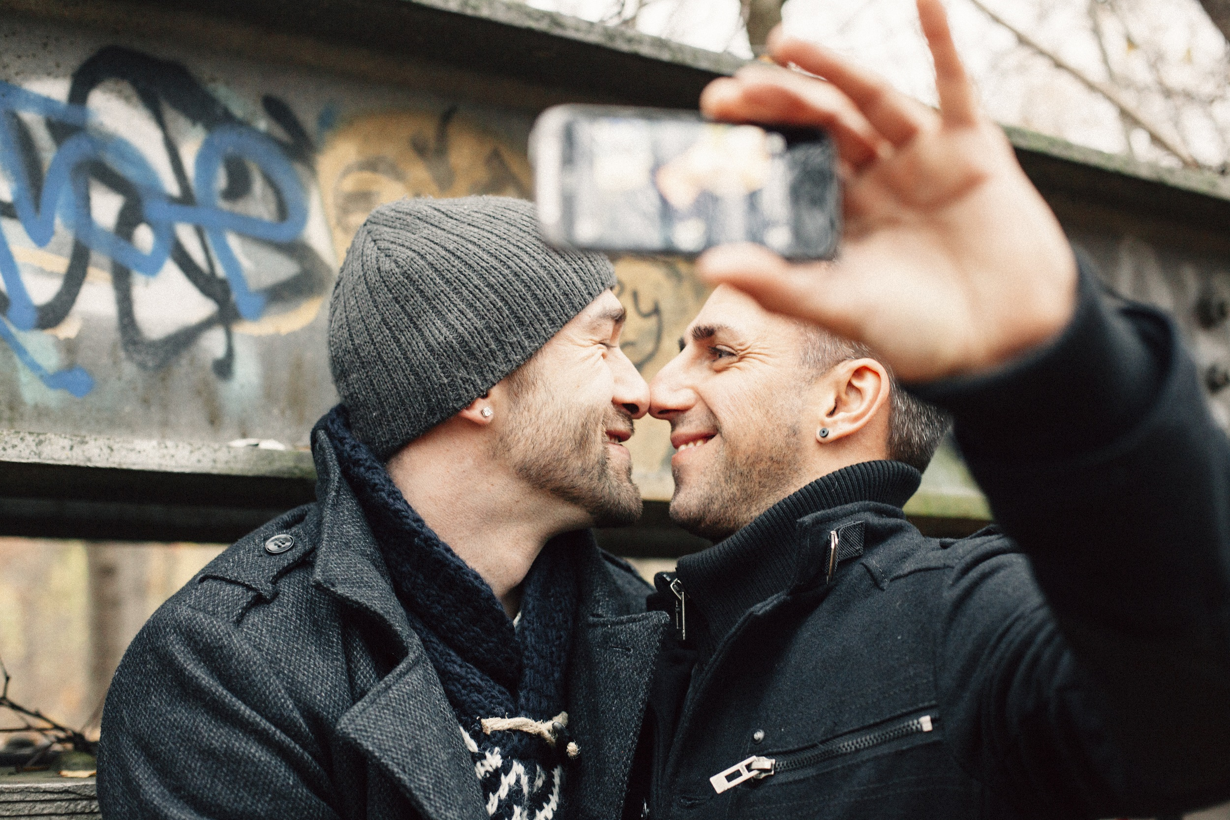 handsome gay couple photographing a selfie