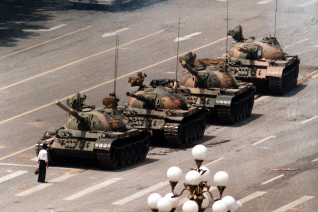 FILE - In this June 5, 1989 file photo, a Chinese protestor blocks a line of tanks heading east on Beijing's Cangan Blvd. June 5, 1989 in front of the Beijing Hotel. The man, calling for an end to the violence and bloodshed against pro-democracy demonstrators, was pulled away by bystanders, and the tanks continued on their way. Thursday June 4, 2009 marks the 20th anniversary of the Chinese military assault on demonstrators on the night of June 3-4, 1989 in Tiananmen Square. (AP Photo/Jeff Widener, File)